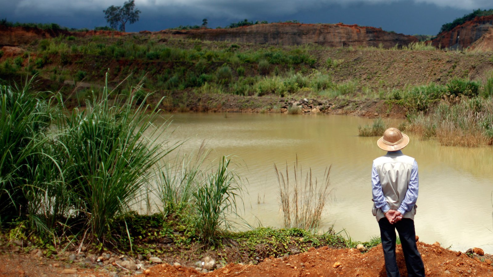 Villager looks at a company jade mining site in Lone Khin town