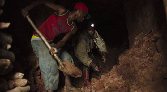 Artisanal miners dig a tunnel of a cassiterite mine on the Kyabumbwa hill, near to the village of Kakulu, in South Kivu in the east of the Democratic Republic of the Congo