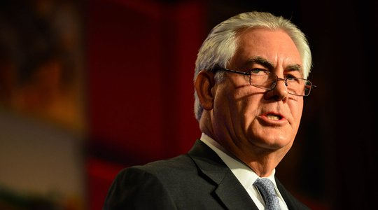 REX W. TILLERSON, Chairman, President and CEO of Exxon Mobil Corporation