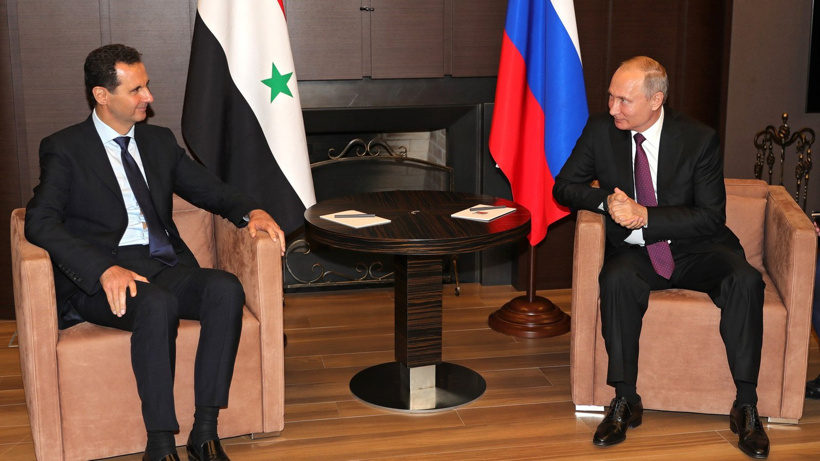 Putin and Assad - Assad's Money Men in Moscow banner image