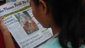 Person reading the Phnom Penh Post Credit: Flickr: tbun